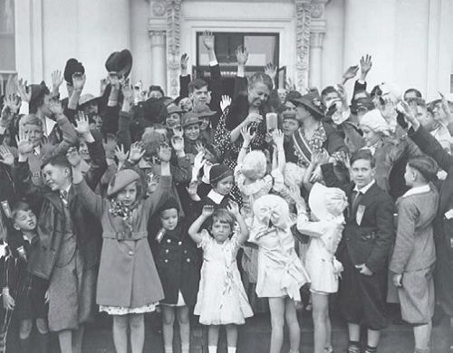 Eleanor Roosevelt top, centre visiting with Children of the American Revolution at the White House, 1935.