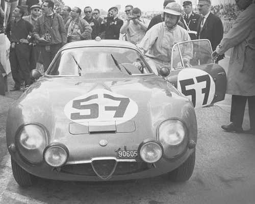 Roberto Bussinello in the Le Mans pits in 1964 with the Alfa Romeo Giulia TZ